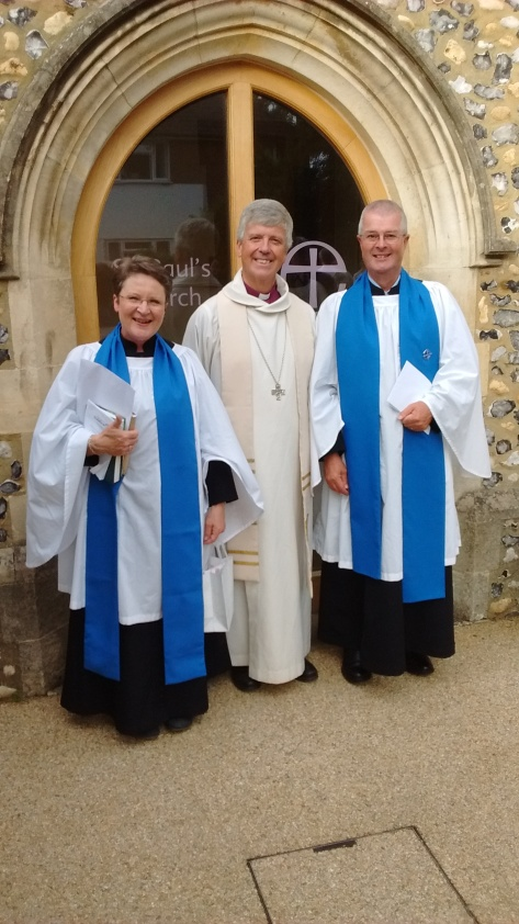 Wendy Edwards, Bishop Andrew and Craig Nobbs outside St Paul's, Dorking, after the service
