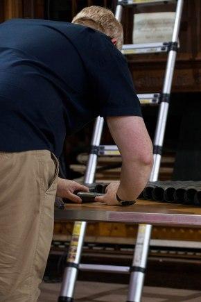 Shawn the restorer at work. Photo by George Britton.