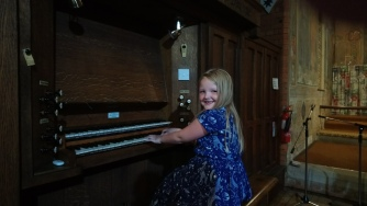 Young Phoebe is already learning the organ.