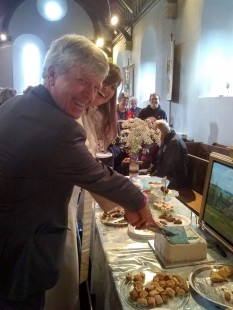 The Bishop of Guildford and Lesley Crawley cut the cake
